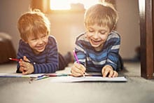 Little-brothers-enjoying-drawing-together-000060545454_Small